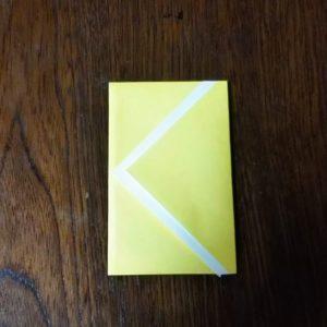 ポチ袋の折り方・・・表向けて完成した黄色の折り紙ポチ袋