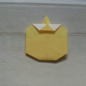 黄色の折り紙で鬼の顔を折りました